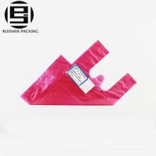 Bolsas plásticas del embalaje de la camiseta rosada de la manija del color