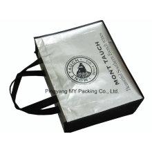 La bolsa de asas no tejida laminada plata de la promoción que hace compras