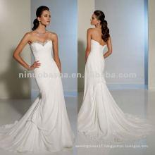 A subtle bustled back chapel length train wedding dress