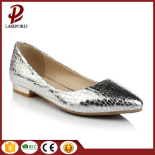 Pointed-toe pump featuring curved flat heel
