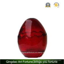 Pot de verre en forme d'oeuf pour le décor de la fête de Pâques