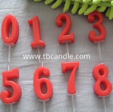red number candle on stick