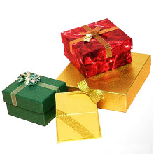 Paper Boxes with Gold Ribbon Crossing