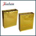 Fertigen Sie goldene holographische Handpaket-Geschenk-Papiertüte besonders an