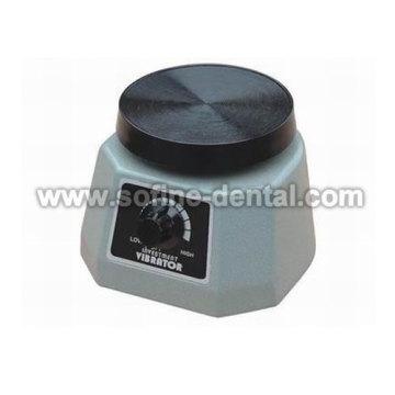 Vibrador dental