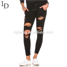 La venta al por mayor de la cintura del lazo negro rasgó pantalones de los pantalones del capri de las señoras para las mujeres