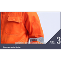 Bata de trabajo protectora anaranjada de la tela de la tela cruzada del poliéster el 35% del uso el 65% para el mecánico de la seguridad en carreteras de la construcción