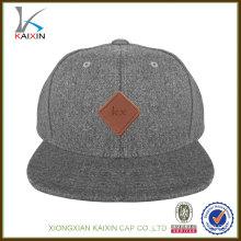 OEM personalizado de cuero patch lana 6 panel de ala plana snapback caps