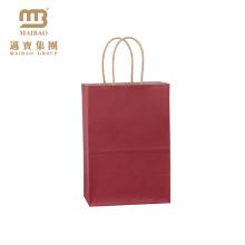 """Petits sacs de papier de cadeau de retour de Kraft de couleur rouge fait sur commande de la couleur rouge 5.25 """"X3.25"""" avec des poignées pour la partie"""