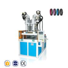 Machine de moulage par injection de plastique rotatif de bracelet de sport