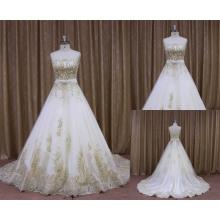Top qualité appliques de dentelle à travers la vraie robe de mariée photo