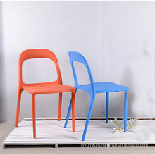 Dining white armless stacking plastic outdoor chair