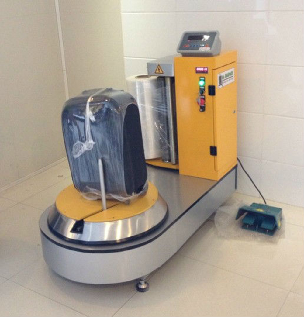 luggage wrapping machine airport