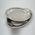 plat de polissage ovale en acier inoxydable argenté de 12 pouces servant un plateau de service