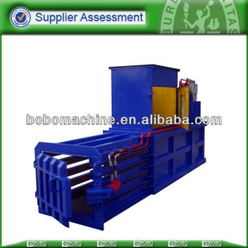 horizontal baler with manual belting
