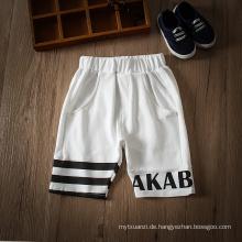 heißes Design Casual Kinderbekleidung weiße und schwarze Hose für 3-8 Jahre Jungen