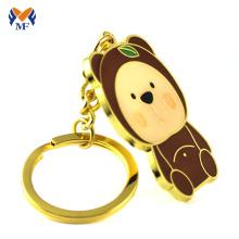 Porte-clés avec ours en métal doré