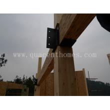 Casa prefabricada con postes y vigas de madera laminada