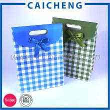 Bolsa de papel barata impresa a medida de bolsas de regalo de producciones de chips