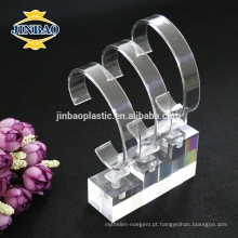 Jinbao personaliza cremalheiras de exposição acrílicas do saco do monóculo do relógio do material