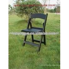 Chaise pliante en résine noire rembourrée en résine