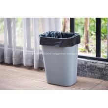 Saco de lixo com fundo estrela selado no rolo