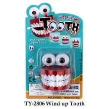 Divertido viento encima del juguete del diente