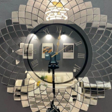 Mirror wall clock made of glass