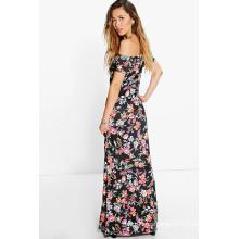 Vestido largo con estampado de flores y hombros de Flora