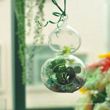 Cabaça artesanal em forma de vidro pendurado
