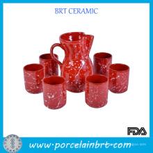 Conjunto de vinho de cerâmica vermelha com salpicos de branco