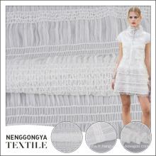 Tissu en mousseline de soie blanc brodé style yoryu 100% polyester