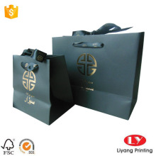 Matt black paper gift bag gold logo