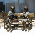 two children sitting on bench reading bronze statue sculpture