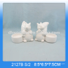 Unique squirrel shaped ceramic animal candle holders in white colour
