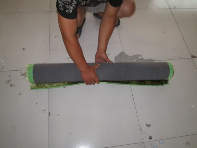 Roll the carpet by hand