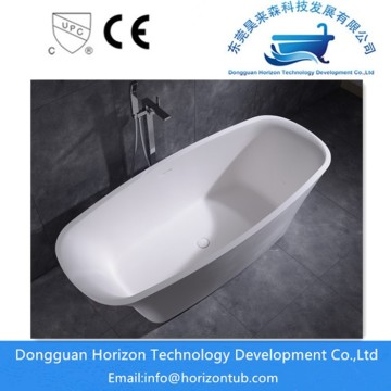 Solid surface freestanding tub