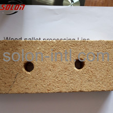 Compressed wood chip block machine