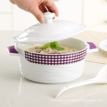 Ceramic casseroles with heat-resistant silicone handle grips