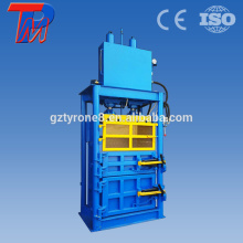 Hydraulic vertical lifting door compressing aluminum scrap baler