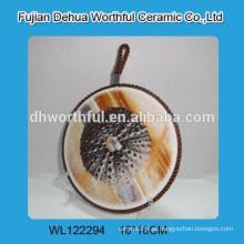2016 Titular de pote de cerâmica de design de mar de alta qualidade com corda de elevação