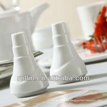 La boda utilizó la coctelera de cerámica blanca de la sal, la coctelera de la pimienta, la sal y la coctelera de pimienta al por mayor