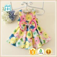 Vestidos de verano de bebé Patrones florales amarillos Vestido de bebé Nuevo estilo de algodón y poliéster Material de seda Precios de vestir de niña