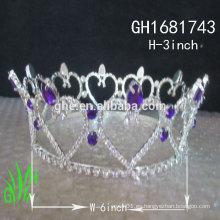 Los nuevos accesorios reales del rhinestone de los diseños venden al por mayor la tiara alta de la corona del desfile