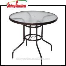 Mesa de comedor redonda de metal Morden con tablero de vidrio
