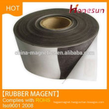 Anisotropic rubber magnet rolls with adhesive