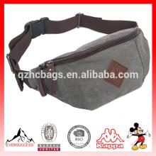 Los hombres y las mujeres portátiles de la moda pequeña lona fanny empacan el bolso para caminar que se ejecuta deportes