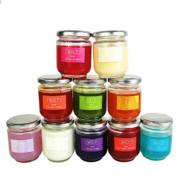 Multi-colored scented candles in round glass