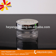 Clear plastic jar with aluminum lid for facial cream