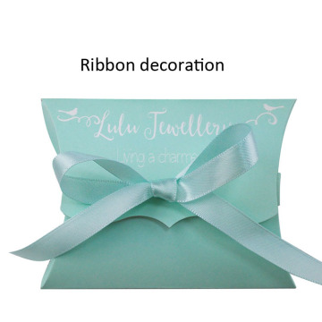coated paper pillow box with bow ribbon